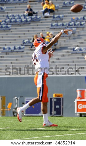 MORGANTOWN, WV - OCTOBER 23: Syracuse quarterback John Kinder delivers a pass during pregame drills October 23, 2010 in Morgantown, WV. - stock photo