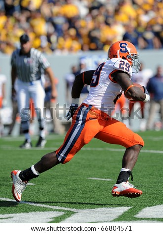 MORGANTOWN, WV - OCTOBER 23: Syracuse University running back Antwon Bailey runs with the ball in the open field in a Big East game October 23, 2010 in Morgantown, WV. - stock photo