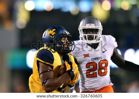 MORGANTOWN, WV - OCTOBER 10: West Virginia Mountaineers cornerback Terrell Chestnut (16) intercepts a pass during the Big 12 football game October 10, 2015 in Morgantown, WV.