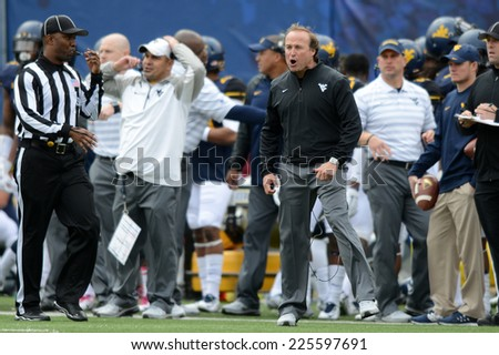 MORGANTOWN, WV - OCTOBER 18: West Virginia Mountaineers head coach Dana Holgorsen reacts to a call he disagrees with during the Big 12 football game October 18, 2014 in Morgantown, WV.  - stock photo