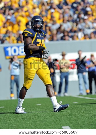 MORGANTOWN, WV - OCTOBER 23: West Virginia University linebacker J.T. Thomas looks to the sideline for the play call in a Big East game October 23, 2010 in Morgantown, WV. - stock photo