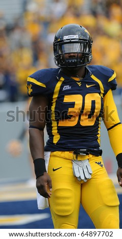MORGANTOWN, WV - OCTOBER 23: West Virginia University linebacker J.T. Thomas warms up just prior to the football on October 23, 2010 in Morgantown, West Virginia. - stock photo