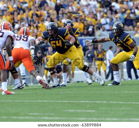 MORGANTOWN, WV - OCTOBER 23: WVU offensive lineman Don Barclay (#64) drops to pass block in a game against Syracuse October 23, 2010 in Morgantown, WV. - stock photo