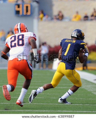 MORGANTOWN, WV - OCTOBER 23: WVU  receiver Tavon Austin (#1) catches a pass against the sidelines in a game against Syracuse October 23, 2010 in Morgantown, WV. - stock photo