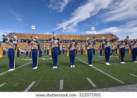 MORGANTOWN, WV - SEPTEMBER 26: A member of the Pride of West Virginia marching band performs during the NCAA football game September 26, 2015 in Morgantown, WV.  - stock photo