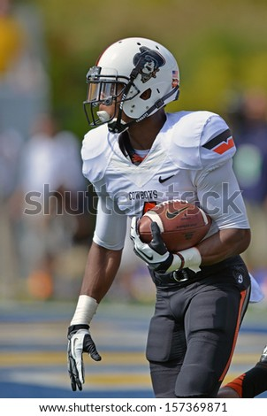 MORGANTOWN, WV - SEPTEMBER 28: Oklahoma State cornerback Justin Gilbert runs with ball on a kick return during the football game September 28, 2013 in Morgantown, WV.