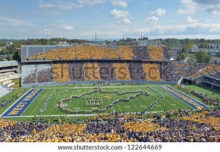 MORGANTOWN, WV - SEPTEMBER 29: The WVU band forms the outline of West Virginia on the field prior to the start of a Big 12 conference football game September 29, 2012 in Morgantown, WV. - stock photo