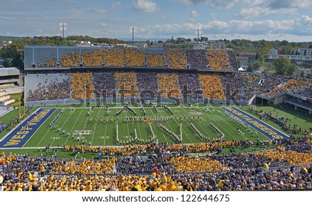 MORGANTOWN, WV - SEPTEMBER 29: The WVU band spells out WVU on the field prior to the start of a Big 12 conference football game September 29, 2012 in Morgantown, WV. - stock photo