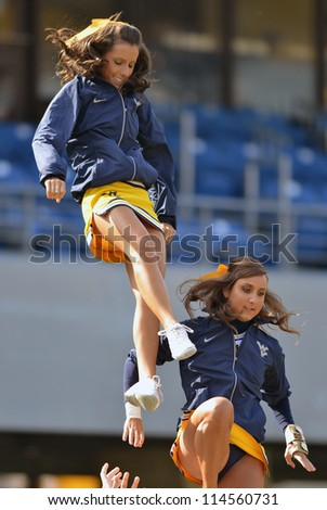 MORGANTOWN, WV - SEPTEMBER 29: The WVU cheerleaders  perform prior to the start of a Big 12 conference football game September 29, 2012 in Morgantown, WV. - stock photo