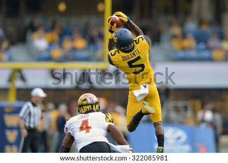 MORGANTOWN, WV - SEPTEMBER 26: West Virginia Mountaineers wide receiver Jovon Durante (5) leaps to make a catch during the NCAA football game September 26, 2015 in Morgantown, WV.  - stock photo