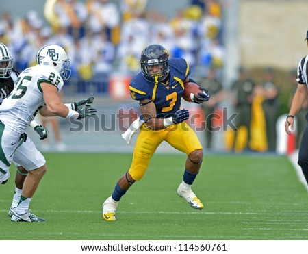 MORGANTOWN, WV - SEPTEMBER 29: WVU receiver Stedman Bailey (#3) runs with the ball after a reception along the sidelines during a Big 12 conference football game September 29, 2012 in Morgantown, WV. - stock photo