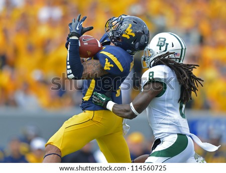 MORGANTOWN, WV - SEPTEMBER 29: WVU wide receiver Stedman Bailey (l) goes up to make a touchdown catch during a Big 12 conference football game September 29, 2012 in Morgantown, WV. - stock photo
