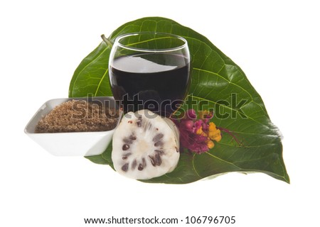 morinda citrifolia juice on a  white background - stock photo