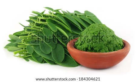 Moringa leaves with paste on a brown bowl - stock photo