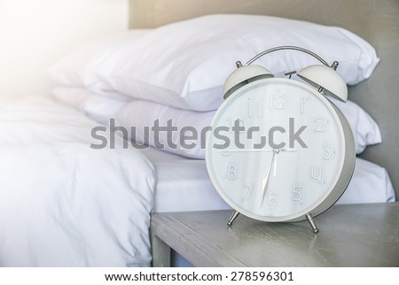Morning alarm clock in bedroom - filter effect - stock photo