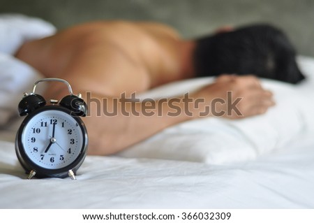 Morning,and people concept - close up of alarm clock in bedroom. - stock photo