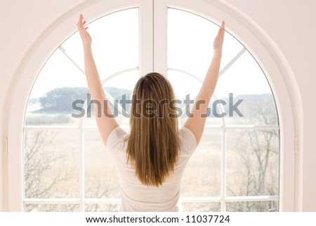 Morning at home / freedom / spring time / woman with long hair - stock photo