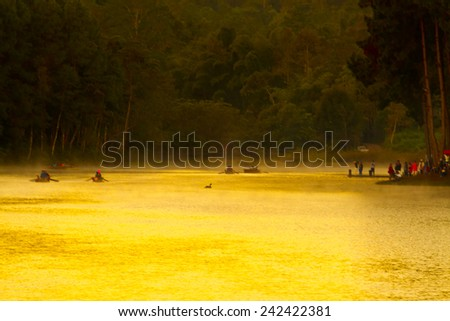 morning at Pang Ung Forestry Plantations with the sun shine on the water ,Maehongson, North of Thailand - stock photo