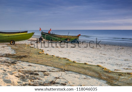 Morning at sandy beach of fishermen village, Baltic Sea, Latvia, Europe - stock photo
