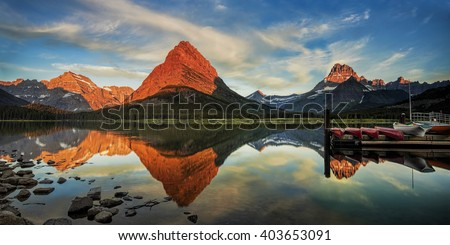 Morning at Swiftcurrent Lake in the Many Glacier area of Montana's Glacier National Park - stock photo