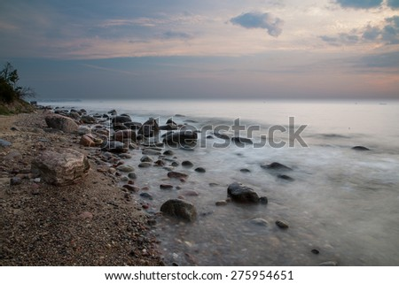 morning at the sea. rock in the sea - stock photo