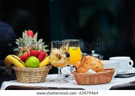 Morning breakfast at the terrace bistro in Paris - stock photo