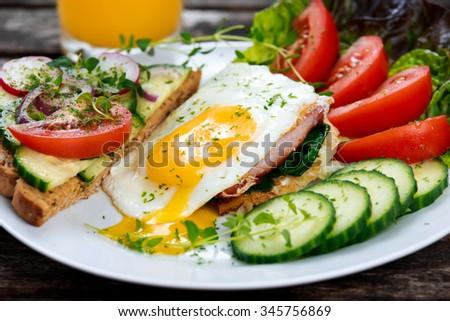 Morning Breakfast - vegan toast sandwich, egg, bacon, and vegetables - stock photo