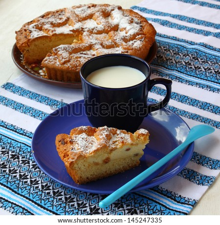 Morning breakfast with cheese cake and a cup of milk - stock photo