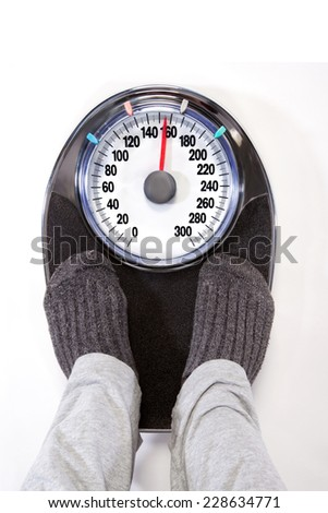 Morning checkup on Weight Scale - stock photo