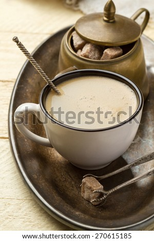 Morning coffee and sugar on a metal tray (close-up) - stock photo