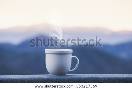 Morning coffee cup with alpine mountain view