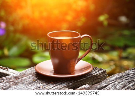morning coffee in the garden - stock photo