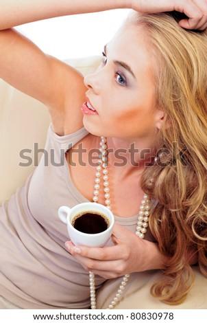 Morning coffee of a stylish beautiful woman - stock photo