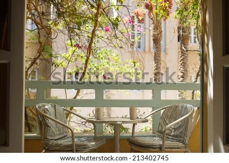Morning coffee on balcony - stock photo