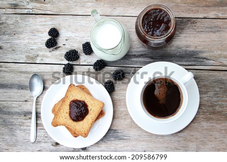 Morning coffee, Toast with marmalade and coffee on wooden table - stock photo