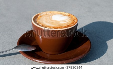 Morning coffee with a heart shape on the top - stock photo
