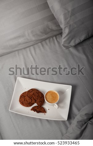 Morning coffee with chocolate cookies in bed