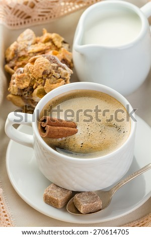 Morning coffee with cinnamon, milk, sugar and cookies (vertical shot) - stock photo
