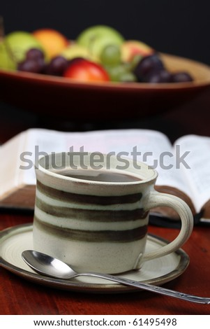Morning coffee with the Bible and fruits in background. Shallow dof - stock photo