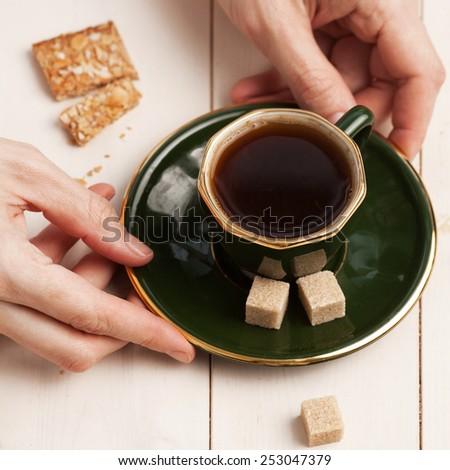 Morning coffee. Young woman drinks coffee  - stock photo