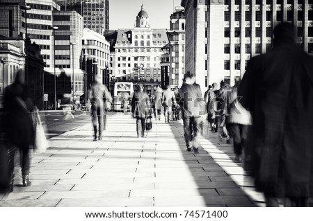 Morning commuters in London. - stock photo