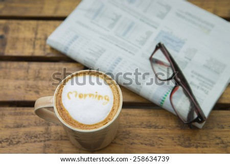 Morning cup of coffee  and newspaper with grasses - stock photo
