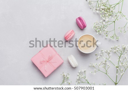 Morning cup coffee cake macaron gift morning cup of coffee cake macaron gift or present box and flower on light negle Images