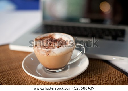 morning, cup of coffee near laptop - stock photo