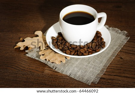 morning cup of coffee on a wooden table - stock photo