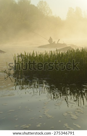 Morning fishing on the river - stock photo