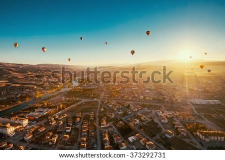 Morning flight above Avanos Valley in Cappadocia. - stock photo