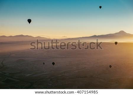 Morning flight above Goreme Valley in Cappadocia. - stock photo