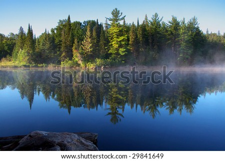 morning fog at algonquin park - stock photo