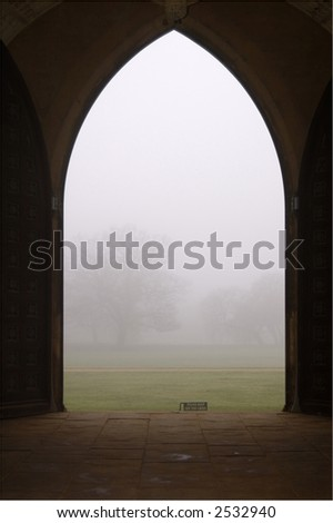 Morning fog in Cambridge, UK, viewed through an arch